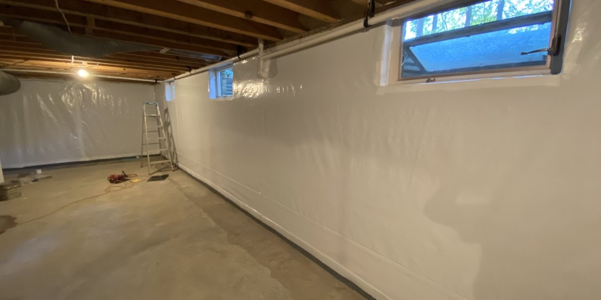 Basement waterproofing and rim joist spray foam insulation as part of encapsulation.