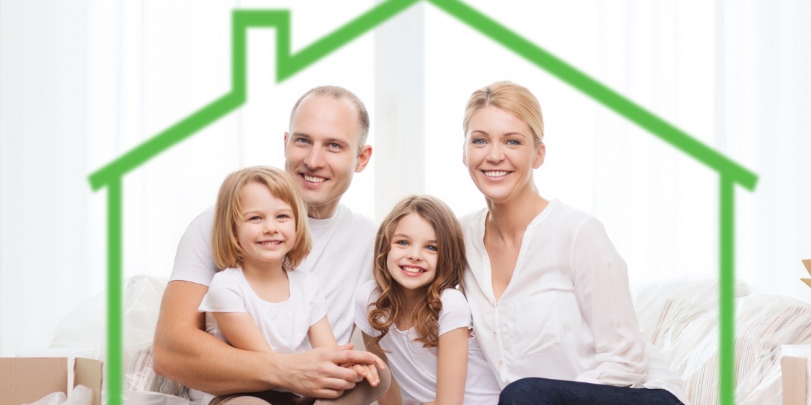 Happy family sitting on a couch with a diagram of a home drawn around them