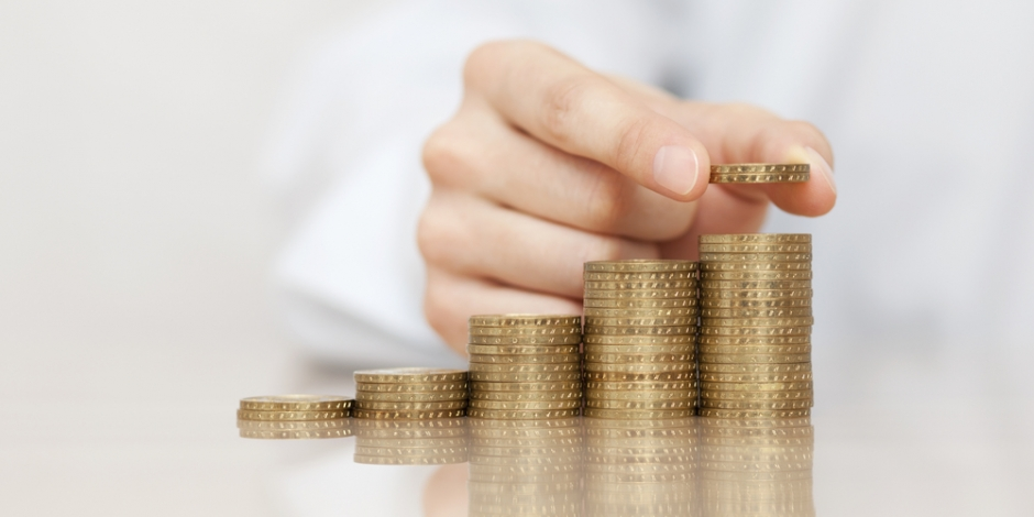 rising stacks of coins, adding value